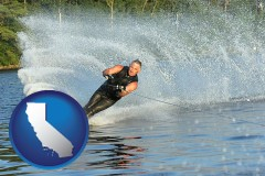 california map icon and a young man waterskiing on a lake