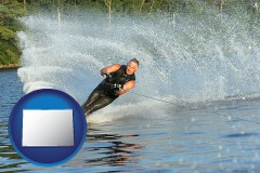 colorado map icon and a young man waterskiing on a lake