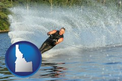 idaho map icon and a young man waterskiing on a lake