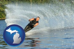 michigan map icon and a young man waterskiing on a lake