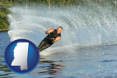 mississippi map icon and a young man waterskiing on a lake