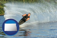 north-dakota map icon and a young man waterskiing on a lake