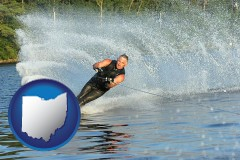 ohio map icon and a young man waterskiing on a lake