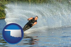 oklahoma map icon and a young man waterskiing on a lake
