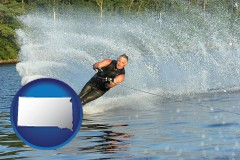 south-dakota map icon and a young man waterskiing on a lake