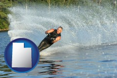utah map icon and a young man waterskiing on a lake