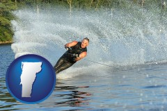 vermont map icon and a young man waterskiing on a lake