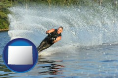 wyoming map icon and a young man waterskiing on a lake