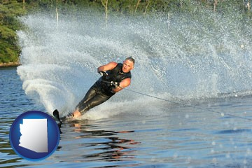 a young man waterskiing on a lake - with Arizona icon