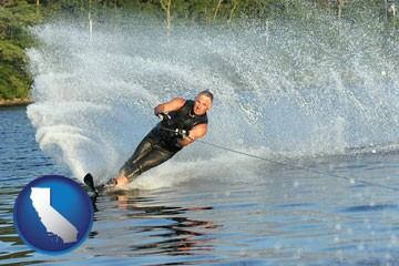 a young man waterskiing on a lake - with California icon