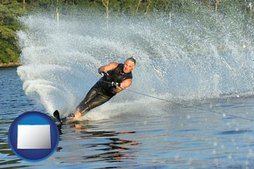 a young man waterskiing on a lake - with Colorado icon