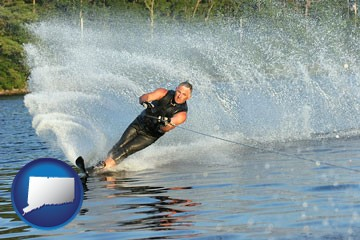 a young man waterskiing on a lake - with Connecticut icon