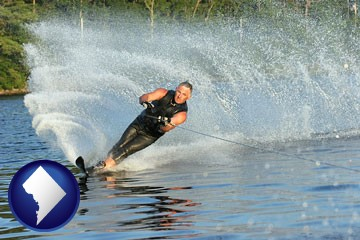 a young man waterskiing on a lake - with Washington, DC icon