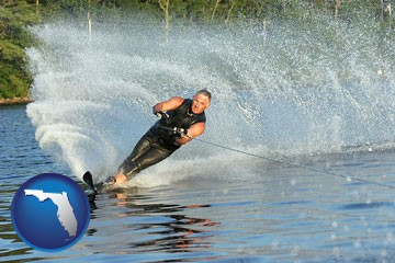 a young man waterskiing on a lake - with Florida icon
