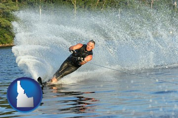 a young man waterskiing on a lake - with Idaho icon