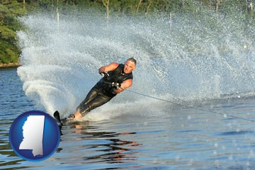 a young man waterskiing on a lake - with Mississippi icon