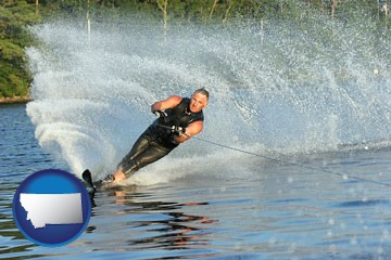 a young man waterskiing on a lake - with Montana icon