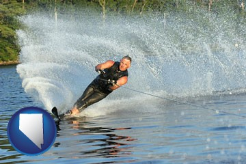 a young man waterskiing on a lake - with Nevada icon