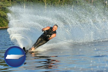 a young man waterskiing on a lake - with Tennessee icon