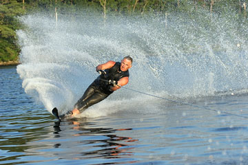 a young man waterskiing on a lake